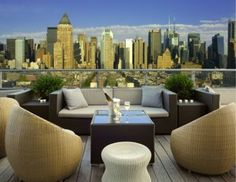 The Press Lounge at Ink 48 in New York City, New York. You will have an excellent view of the Manhatten skyline and the Hudson River on the west side of this 16th-story lounge. Signature Drink: De Telegraaf {gin, lemon and triple sec, served over an absinthe wash}