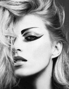 Edgy eye makeup look. Reminds me of Siouxsie and the Banshees