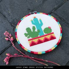A simple and easy botanic cactus a modern cross stitch pattern featuring three cacti that bring the Mexican outdoors indoors. Spruce up a blank wall quickly and add a colorful desert atmosphere above your succulent pot plants! With no backstitches or hal Modern Cross Stitch Patterns, Star Patterns, Counted Cross Stitch Patterns, Beading Patterns, Embroidery Hoop Art, Cross Stitch Embroidery, Cactus Cross Stitch, Star Stitch, Dmc Floss