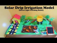 solar drip irrigation model (with street light working model) Science Exhibition Projects, School Science Projects, Science Experiments Kids, Science Fair, Science For Kids, Drip Irrigation System Design, Sprinkler System Design, Science Project Working Model, Science Models