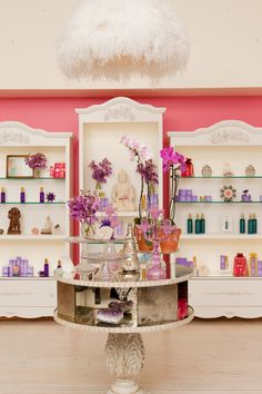 I love the main idea of the cabinets for possibly a product case :)... and the flowers are cute(: