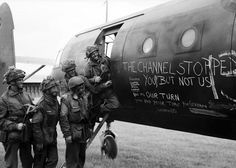 Men of the 6th Airlanding Brigade laugh at the text on their Horsa glider as they prepare to fly out to France.