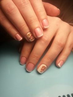 White French manicure on short nails.