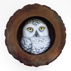 A Painted Snowy Owl in His Wooden Nest, a Unique Handmade 3-D Artwork by Roberto Rizzo! This is a unique piece of art! I realized it assembling a handpainted snowy owl made in clay in a hollow wooden trunk section with a power glue. The artwork is painted with high quality acrylics