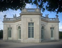 French Pavilion of Petit Trianon at the Palace of Versailles. Built by Gabriel in 1750, it was one of Louis XV's first creations in the Trianon area. It comprises a vast circular salon flanked by four small rooms used as a boudoir, a rechauffoir or room for warming up food, a kitchen and a wardrobe.