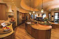 Wow!! That is a huge kitchen!! Love it!