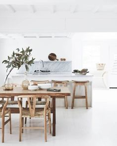 Kitchen: Timber furniture, including a dining table and stools sourced from Bali, add warmth to the pale surfaces in the kitchen, which has been painted in Porter's Paints Popcorn. Home Decor Kitchen, Kitchen Living, Home Kitchens, Decorating Kitchen, Kitchen Ideas, Modern Kitchens, Küchen Design, Home Design, Layout Design
