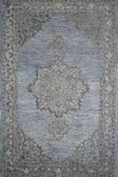 This hand-tufted area rug features a transitional design in contemporary light blue tones. Made of wool on a cotton foundation. Medium pile. #bluerug #transitionalrug #handmaderug Light Blue Area Rug, Blue Area Rugs, Transitional Area Rugs, Blue Tones, Modern Rugs, Rug Making, Persian Rug, Traditional Design, Rug Features