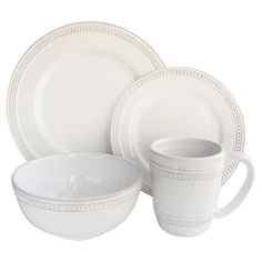 An elegant stage for your culinary creations, this eye-catching dinnerware set showcases dotted rims and a crisp white hue.   Produ...