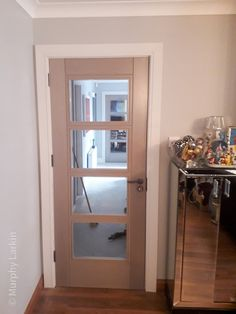 Light Grey Ash Glass Doors recently installed by our expert fitting team. Grey doors available from our Showrooms in Tramore and Clonmel and online. Grey Doors, Oak Doors, Walnut Doors, Prehung Doors, Composite Door, External Doors, Contemporary Doors, Architrave, Attic Conversion