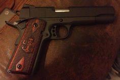 Gun with Navy Chief emblem...gotta get one of these.