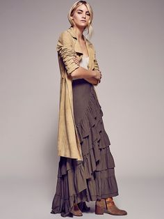 Enya Skirt | Multi-tiered maxi wrap skirt with ruffle detailing and an adjustable tie at the waist.
