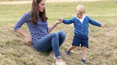 Prince George casually kicked it in his Crocs.