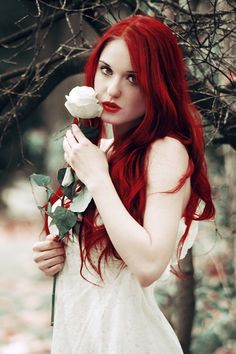 dark red hair..i don't love the hair but i love the pose and the expression.