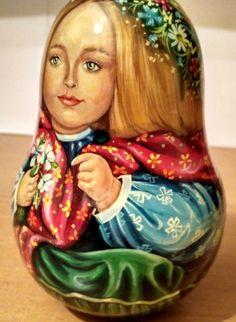 "THe doll is 5,2"" tall. It has a bell inside.   eBay!"