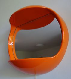 Orange space age mirror with double light by LilleFrokenSolskinn