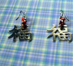 Happiness Caligraphy Earrings by ~prheat on deviantART