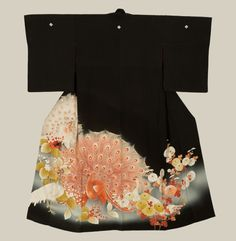 A formal silk kurotomesode featuring a large peacock. Yuzen-dyeing and embroidery. Taisho to early Showa period (1912-1935), Japan.  The Kimono Gallery