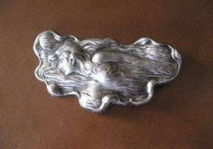Vintage silver art nouveau style lady of the sea brooch.