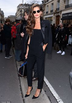 Back to black: The supermodel opted for an androgynous look in a fitted jumpsuit and black tuxedo jacket
