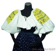 The blouse is made from cotton and features stunning openwork tambour embroidery on the sleeves. Search for us online for all your ethnic fashion needs! Folk Costume, Costumes, Tambour Embroidery, Embroidered Blouse, Ethnic Fashion, Bell Sleeve Top, Yellow, Sleeves, Cotton