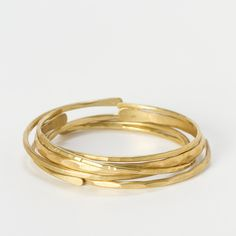 Hand-Hammered Bangle Set: this unique, hand-crafted set only gets better with age: the brass will develop a deep gold patina, as the edges smooth and soften. Handmade in Cape Cod by eco-friendly Bonnie Bracelets.