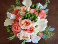 hypericum berries, garden roses, callas, roses, greenery.. got to love bridal bouquets :)