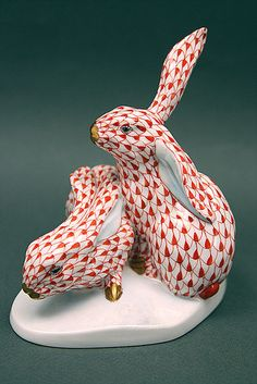 Herend Hand Painted Porcelain Figurine of Two Bunnies One Croched Down One Sitting Up, Red Fishnet w Gold Accents.