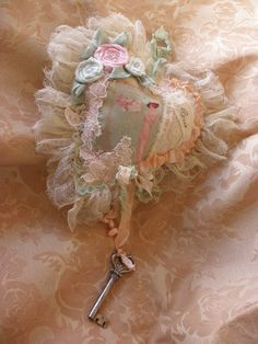 A Parisian Tattered Key to My Heart Lavender Scented Hanging Shabby Chic Pillowette with Roses and Crystals. $27.00, via Etsy.