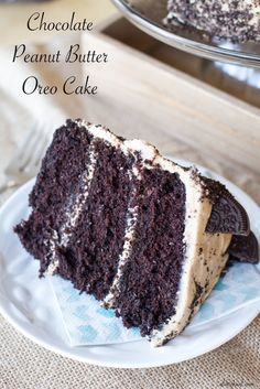The classic combination of peanut butter and chocolate is taken to a whole new level with this chocolate cake topped with peanut butter frosting and crushed peanut butter cup Oreos! | www.alattefood.com