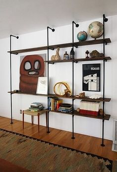 This style of pipe shelf unit has caught on like wildfire in the design blogs. Originally conceived by Commune for the Ace Hotel Palm Springs lobby, it has inspired many design-savvy DIYers to construct their own versions out of plumbing pipe and wood planks. ///// Very cute possibly for TV/Game/Office space...... Love this!!!