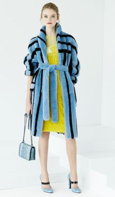blue black fur coat and yellow dress