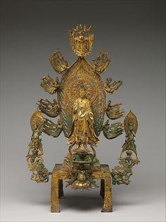 彌勒佛 Altarpiece dedicated to the Buddha Maitreya (Mile fo)  Period:     late Northern Wei (386–534)–Eastern Wei (534–550) dynasty  Date:     ca. 525–35  Culture:     China  Medium:     Gilt bronze; probably piece-mold and lost-wax cast  Dimensions:     H. 23 1/4 in. (59.1 cm); W. 15 in. (38.1 cm); D. 7 1/2 in. (19.1 cm)  Classification:     Sculpture
