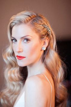 This hairstyle reminiscent of the 1940's is a must have for a mid century vintage wedding theme