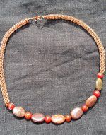 Red agates , rainbow stone and Viking knitted copper wire.