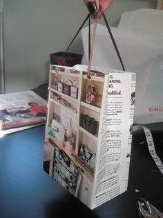 Do this with the old Premier catalog pages. Tutorial - How to Make a Gift Bag Out of a Catalog or Magazine