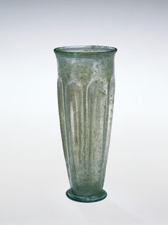 1st C. Roman Blown Glass Beaker with 8 long vertical indentations. Base; folded tubular edge.