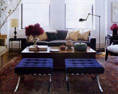 Modern-traditional mix: Persian carpet + Knoll Barcelona stools, from Elle Decor by xJavierx, via Flickr