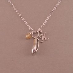 """Ballet Slipper Necklace, Sterling Silver, Dancer, ballerina, ballet shoe charm, birthday necklace, recital gift idea, dance jewelry, girl. $32.00, via Etsy. with an """"E"""" instead of a """"K"""""""
