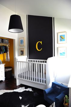Thick black stripe behind crib adds impact in this traditional boy's nursery. #projectnursery