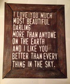 Rustic, wooden, E.E. Cummings poem sign