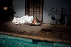 Kurt Cobain sleeping on photo the set of Nevermind cover.