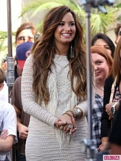 Demi Lovato - her hair is brownish with red in it....maybe my next choice