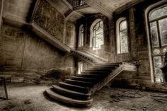 Abandoned and derelict staircase.  Looks like it would have been a beautiful room once.