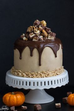 Pumpkin Snickers Layer Cake with Salted Caramel Frosting  -  three layer pumpkin cake with Snickers, salted caramel frosting - topped with chocolate ganache, Snickers and caramel popcorn. Delicious & perfect for any special occasion.: