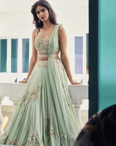 Mehr - our Sangeet favourite. Soft mint green Lehenga intricately embroidered with gold and peach silk thread in delicate floral patterns… Indian Lehenga, Lehenga Sari, Green Lehenga, Lehnga Dress, Indian Gowns, Indian Attire, Anarkali, Gold Lehenga, Floral Lehenga
