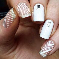 In order to achieve this design, you need a thin nail brush. You may also need some strips for this design. Otherwise, you can do very well on the plain white with silver rectangle plate.