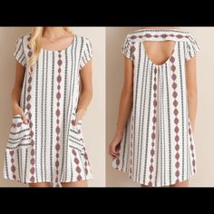 """LOWEST PRICE** Tribal Print Ivory Shift Dress Really sweet and comfy shift dress. Print colors are a dark blue and burgundy. Two pockets in front of the dress, is non-sheer fully lined, 100% rayon, 40"""" bust, 34"""" waist. Worn twice. Dresses"""
