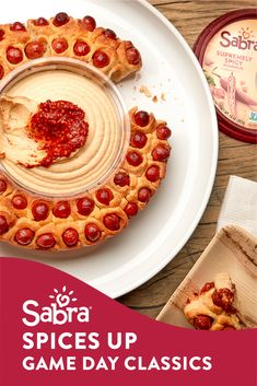 """Make small spicy piglets in a blanket using mini hotdogs or little smokies. Place a circular disc of aluminum foil (the size of a 10-ounce container of Sabra Hummus) in the center of a pie dish and arrange the """"piglets"""" around it. Bake In a preheated 350- degree oven until browned and cooked through. Carefully remove aluminum disc using tongs. Place piglet wreath on a serving dish. Place Sabra Supremely spicy hummus in the center and serve. Recipes Appetizers And Snacks, Appetizers For Party, Snack Recipes, Cooking Recipes, Desserts, Party Food Platters, Good Food, Yummy Food, Sauces"""