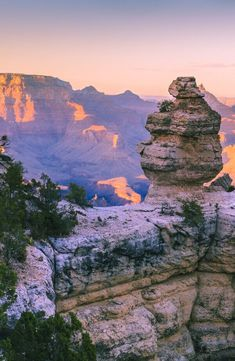 SUN SETTING OVER GRAND CANYON NATIONAL PARK, ARIZONA